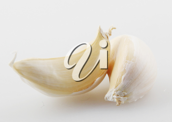 Close-Up Of Garlic Clove Against White Background