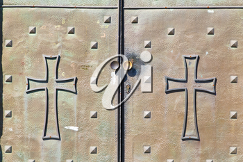 italy  patch lombardy    cross castellanza blur   abstract   rusty brass brown knocker in a  door curch  closed wood