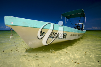 a boat in the blue lagoon of sian kaan in mexico