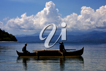 two man in a boat in madagascar for fishing