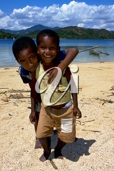 two little boys in a beach in madagascar