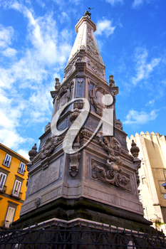 marble statue of obelisk immacolata  in the center of naples italy church