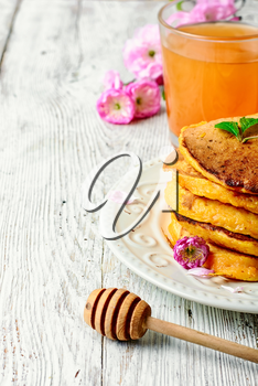 pumpkin pancakes with light dishes and glass of juice