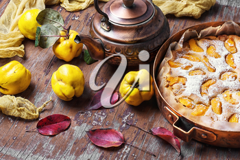 Pie autumn quinces baked in the stylish copper retro form