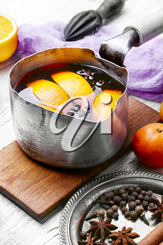 hot drink based on red wine,orange and spices in saucepan