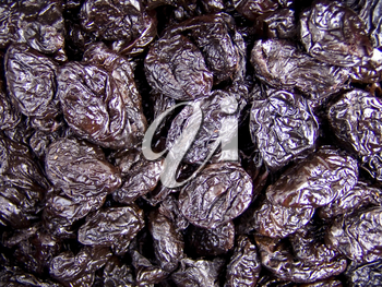 Agricultural background; a pile of beautiful prunes