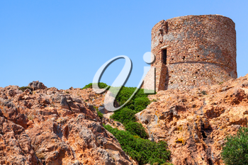 Ancient Genoese tower on Capo Rosso cliff, Corsica island, France