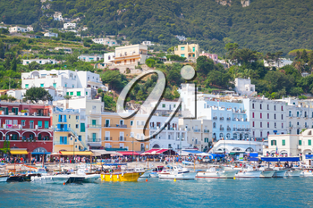Port of Capri, Italy. Colorful houses and pleasure yachts