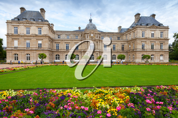 Paris, France - August 10, 2014: Luxembourg Palace facade and colorful flowers of the Luxembourg Garden in Paris