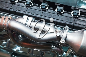 Cylinder block and air blower pipe. Sport car motor parts, automotive V12 engine fragment, closeup photo with selective focus