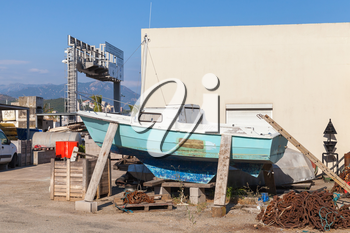 Old wooden yacht repairing, port of Ajaccio, Corsica, France