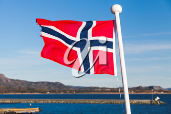 Flag of Norway waving over blue sky background