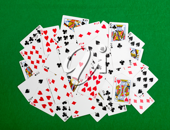 Heap of gambling cards on green table