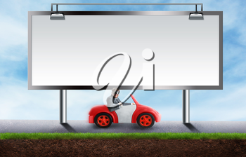 Young businessman driving a toy car on a road under the billboard