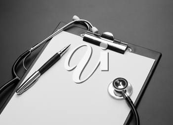 Clipboard, pen and medical stethoscope