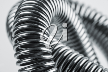 Close-up of coiled metal springs