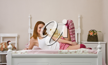 Teen on bed