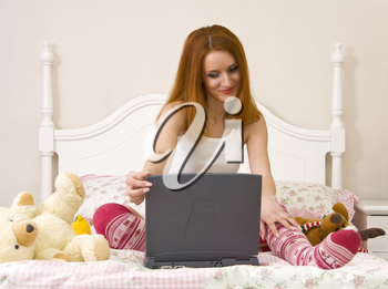 Playful teen on bed with notebook