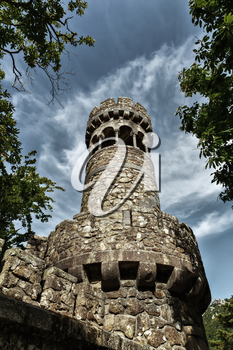 Bottom view of ancient tower against the sky