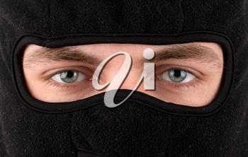 Close-up view of man in black balaclava