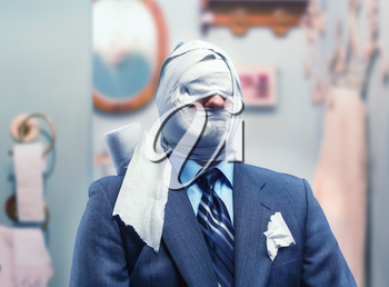 Businessman in toilet paper in the bathroom