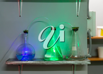 Three flasks with chemical reagents