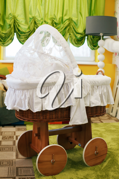 Preschool room decorated with baby carriage and carpet on the floor. Kindergarten concept.