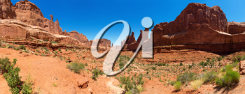 Mountains in valley against blue sky background. Landscape of Arches National Park
