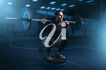 Strength athlete on training, workout with barbell in gym. Active sport exercises in fitness club