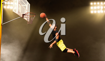 Basketball player makes a throw, shoot in action, dark background. Male athlete in sportswear scores on streetball training