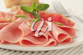Thin slices of ham on a plate