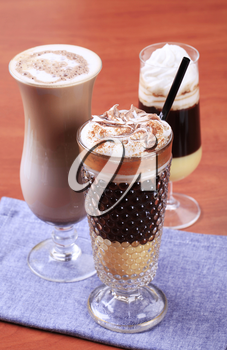 Coffee and chocolate drinks in tall glasses