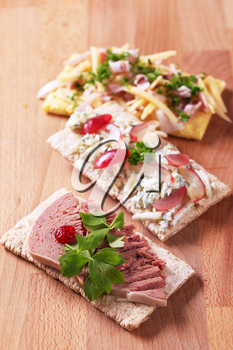 Crisp bread with various savory toppings