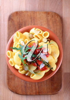 Macaroni with capers, crushed tomatoes and Parmesan
