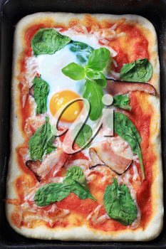 Bacon and egg pizza baked in a rectangular tray