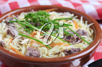 Bowl of beef soup with homemade noodles