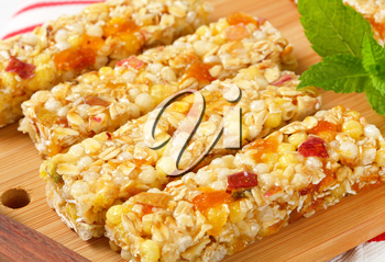 Cereal bars with pieces of dried apricot and apple