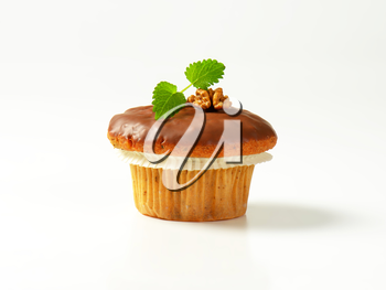 Nut muffin with chocolate glaze