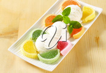 Scoops of white ice cream garnished with jelly candy