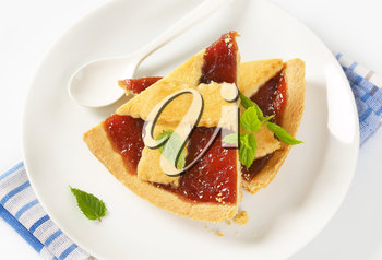 slices of strawberry jam tart  on white plate