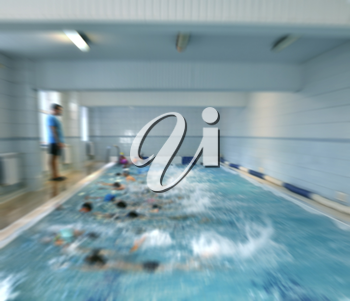 children in swimming lessons with a coach at the pool  creative abstract blur background with bokeh effect
