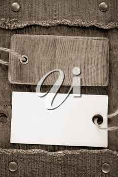 blue jean and price tag on wood texture background