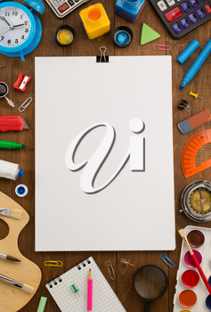 school supplies and paper on wooden background