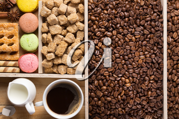 coffee beans in wooden plank box background, top view