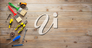 set of tools and instruments at wooden surface background
