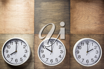 wall clock at wooden background surface