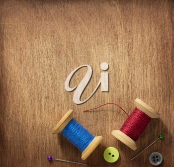 sewing tools and accessories on wooden table background