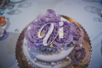 Ornaments on a pie from violet flowers.