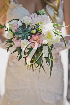 Bouquet of gorgeous flowers in womens hands.