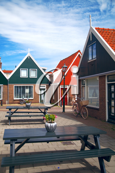 Vintage Dutch town of Volendam European evening. Retro style. houses and bikes on the street in the summer